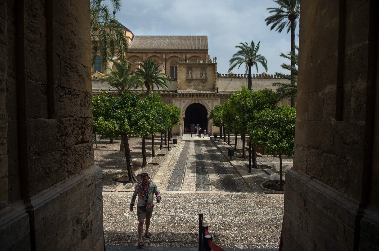 A tourist visits the Patio de los Naranjos (Garden of oranges) at The Mezquita (mosque) in Cordoba after restrictions were lifted following a national lockdown put in place to fight the coronavirus pandemic, Cardoba, Spain, July 8, 2020. (AFP Photo)