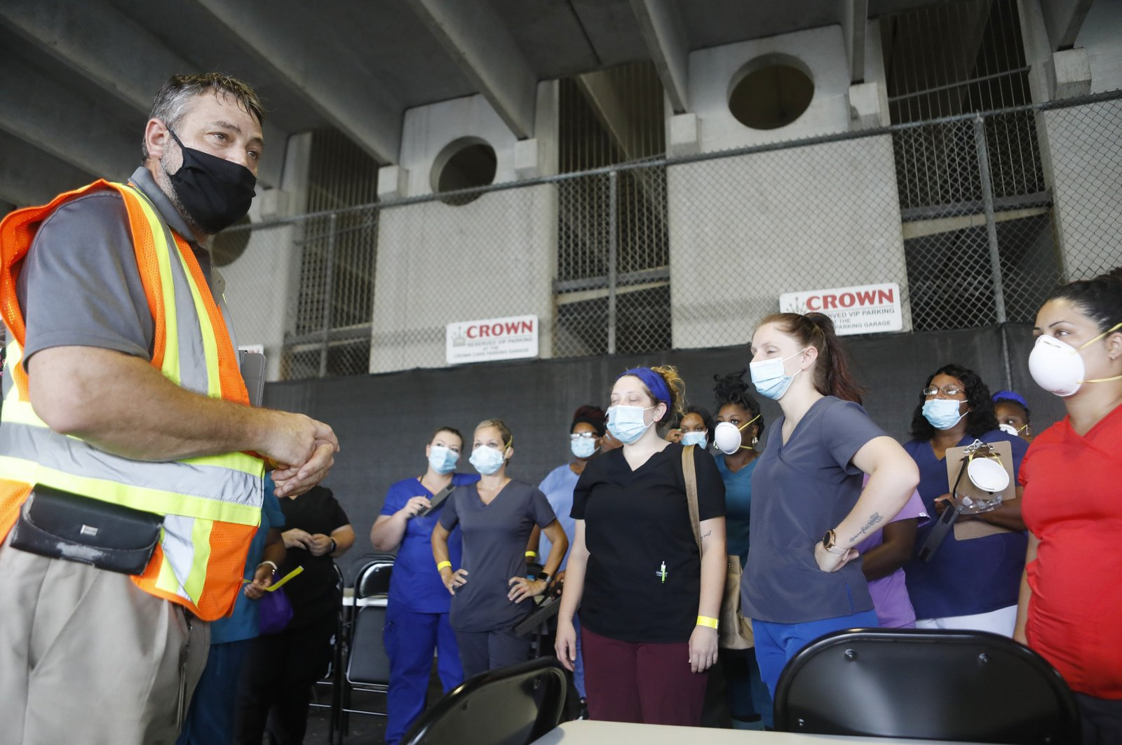 Health care workers meet before COVID-19 drive-thru testing begins at the Duke Energy for the Arts Mahaffey Theater, in St. Petersburg, Florida, U.S., July 8, 2020. (AFP Photo)