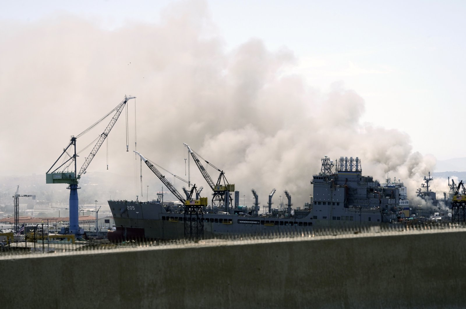 Smoke rises from a fire on board the U.S. Navy amphibious assault ship USS Bonhomme Richard at Naval Base San Diego, California, U.S., July 12, 2020. (Reuters Photo)