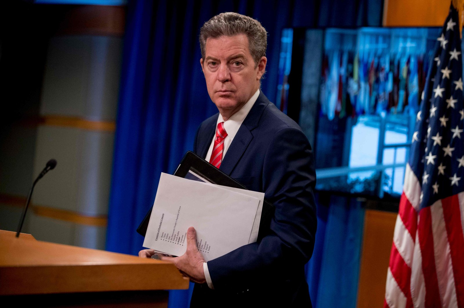 Ambassador at Large for International Religious Freedom, Sam Brownback, departs after speaking during a news conference at the State Department in Washington, D.C., June 10, 2020. (AFP Photo)