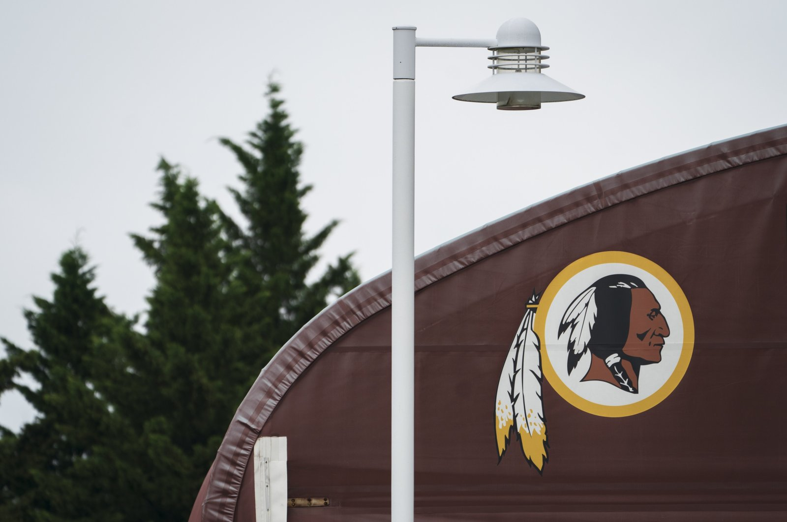 A Washington Redskins logo is seen on the outside of FedEx Field in Landover, Maryland, July 7, 2020. (AFP Photo)
