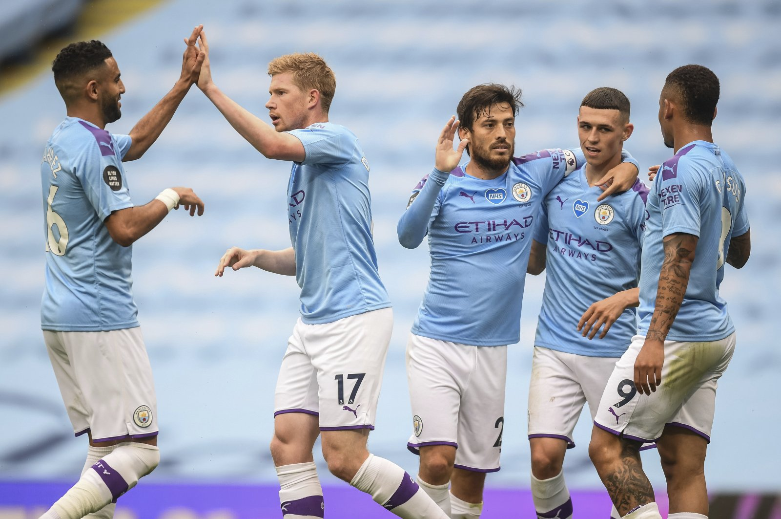 Manchester City players celebrate after scoring their second goal during the English Premier League soccer match between Manchester City and Newcastle at the Ethiad Stadium in Manchester, England, Wednesday, July 8, 2020. (Pool via AP)