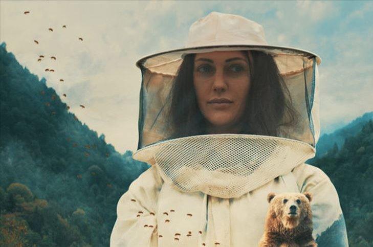 "Still shot from ""Kovan"" showing Meryem Uzerli in her role as a beekeper woman."