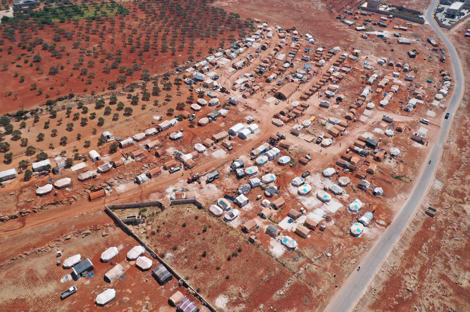 An aerial view of a camp for displaced Syrians near the town of Maaret Misrin in Syria's northwestern Idlib province, July 11, 2020. (AFP Photo)