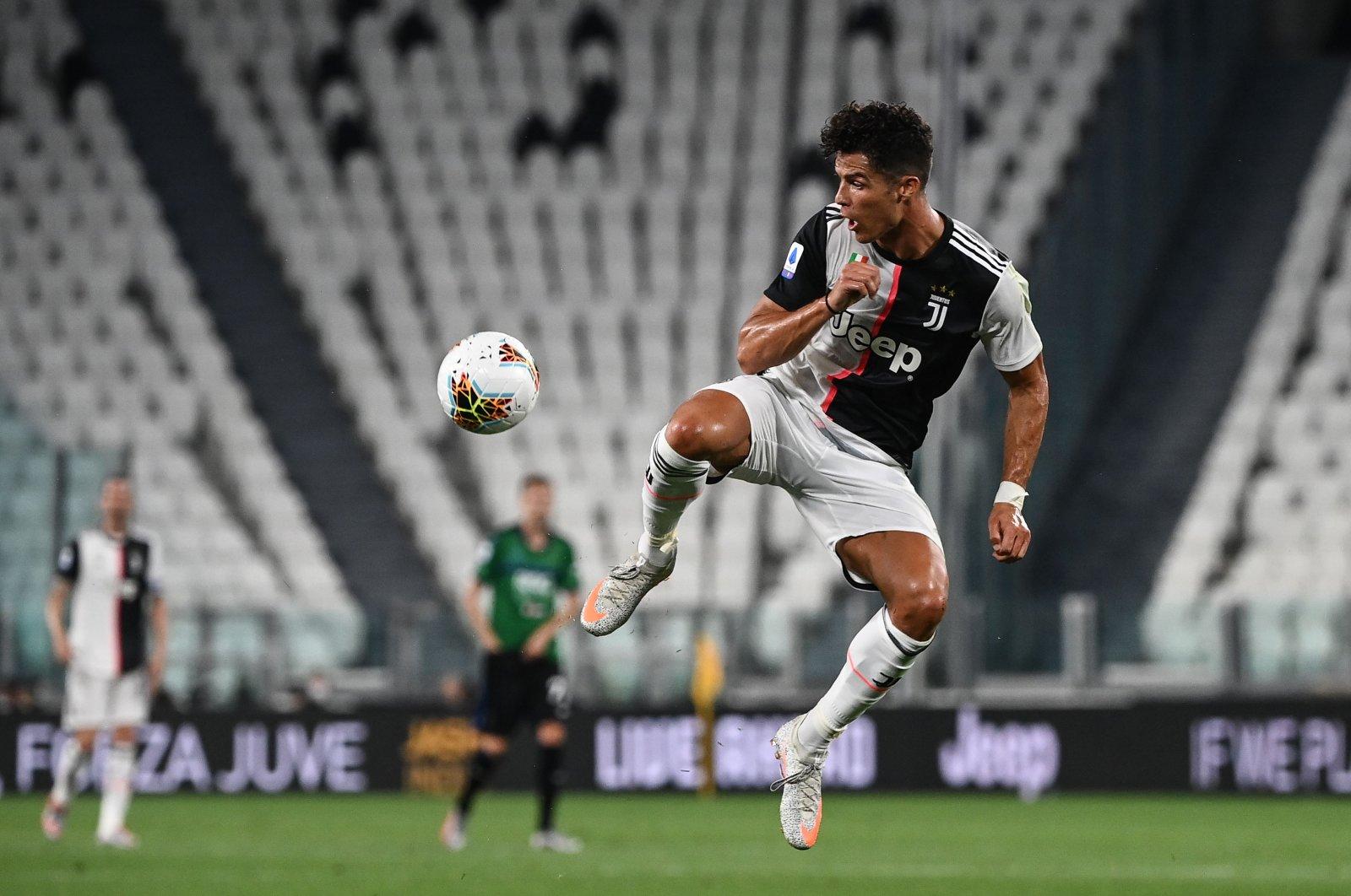 Juventus'  Cristiano Ronaldo controls the ball during a match between Juventus and Atalanta, in Turin, Italy, July 11, 2020. (AFP PHOTO)