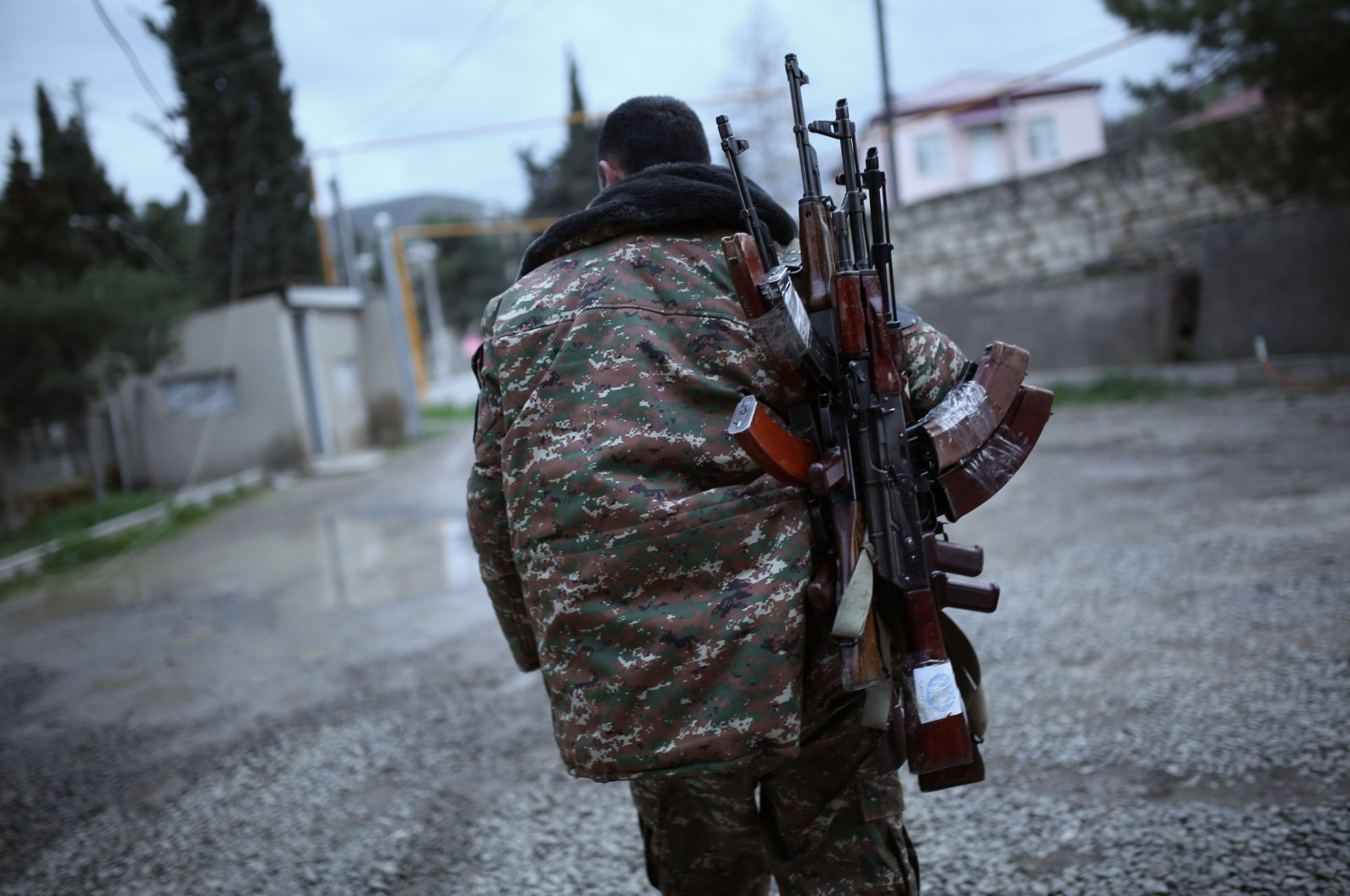In this file photo taken on April 4, 2016, a soldier of the self-defence army of Nagorno-Karabakh carries weapons in the Martakert region. (AFP Photo)