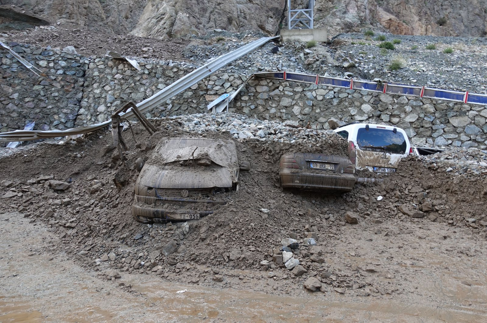 Cars buried under mud after the floods in Artvin, Turkey, July 13, 2020. (AA Photo)