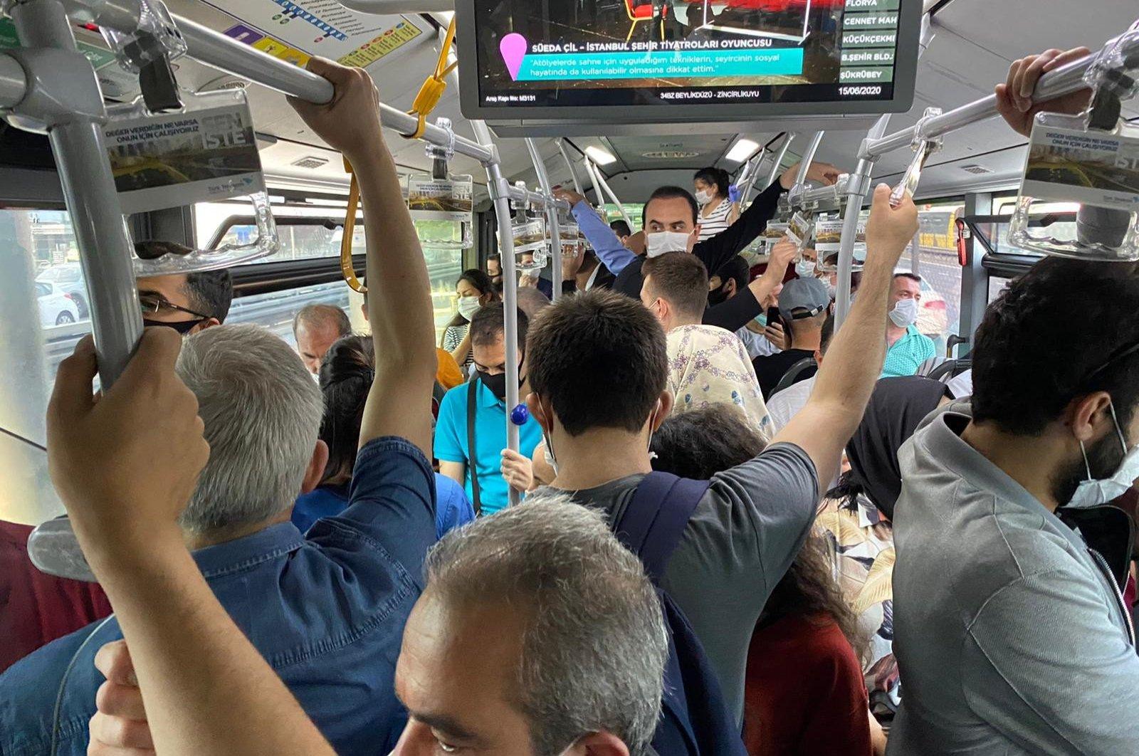 People travel in a metrobus, in Istanbul, Turkey, June 15, 2020. (IHA Photo)