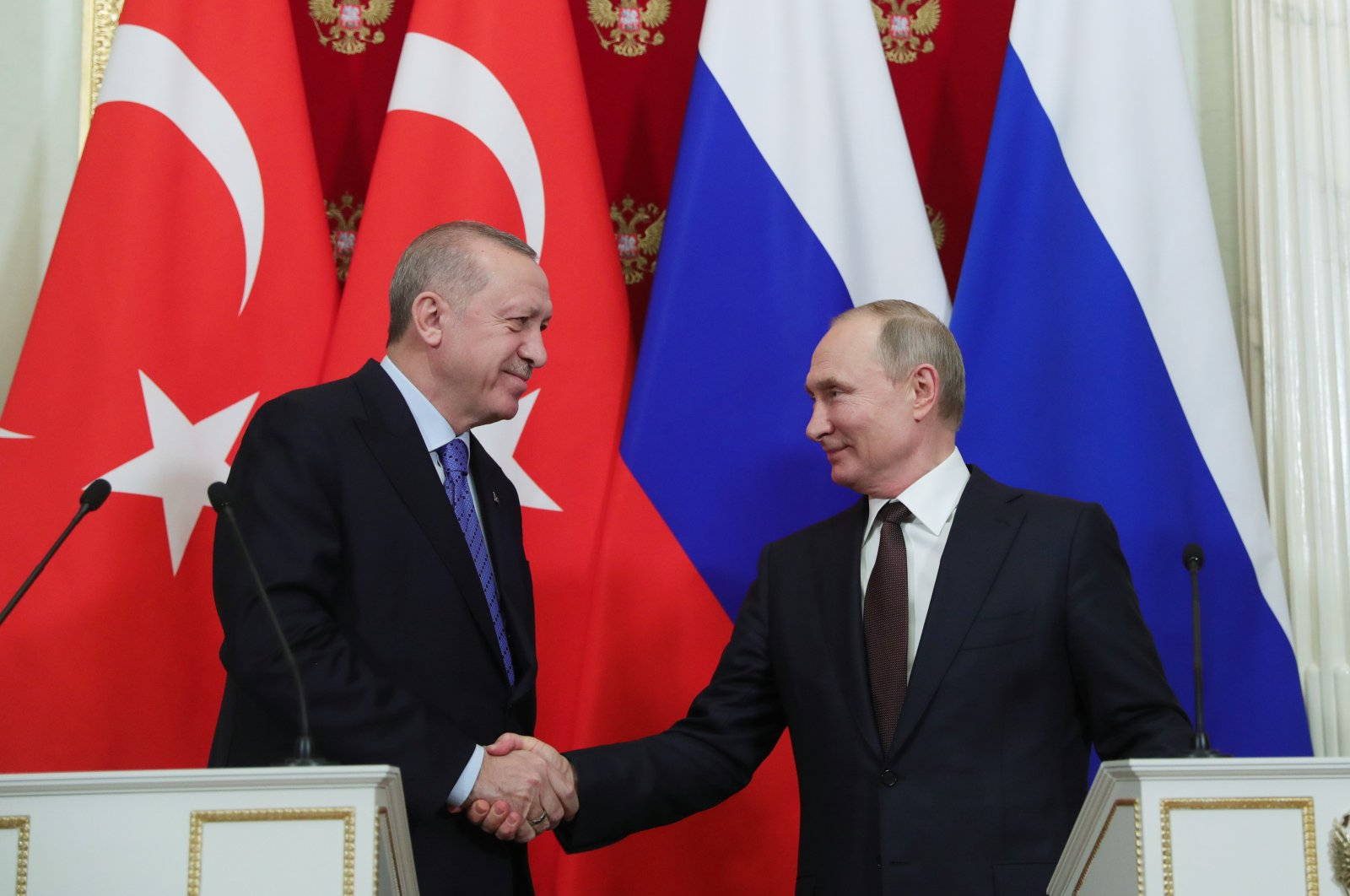President Recep Tayyip Erdoğan shakes hand with his Russian counterpart Vladimir Putin following a press conference in Moscow, March 6, 2020. (AA)