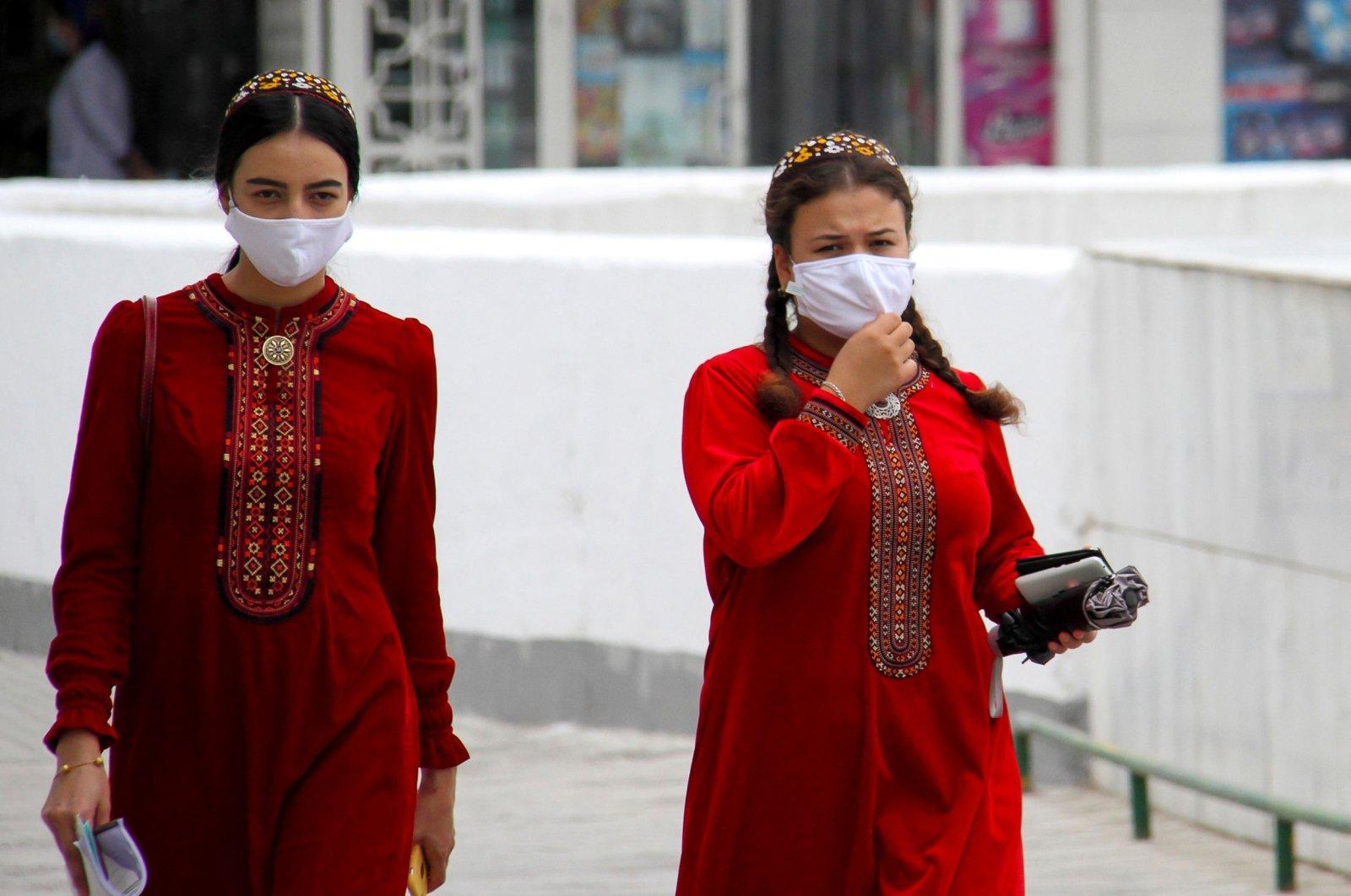 Turkmen women wearing face masks walk in Ashgabat on July 13, 2020. (Photo by STR / AFP)
