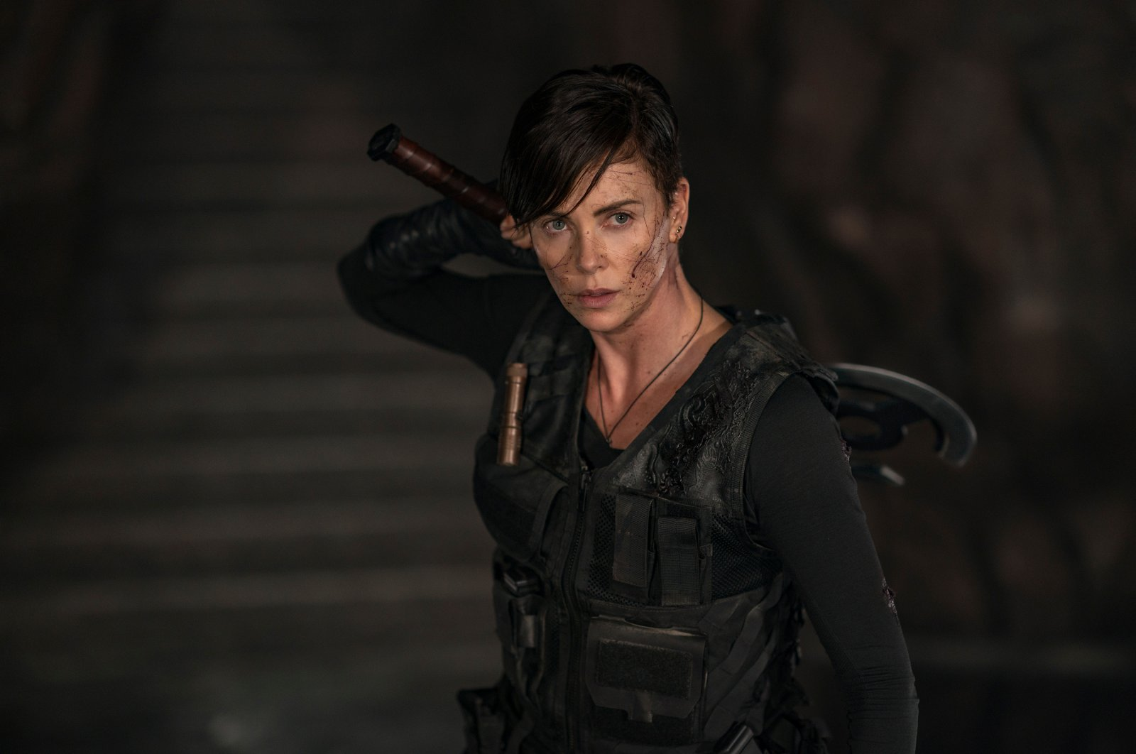 "This image released by Netflix shows Charlize Theron in a scene from ""The Old Guard."" (AP Photo)"