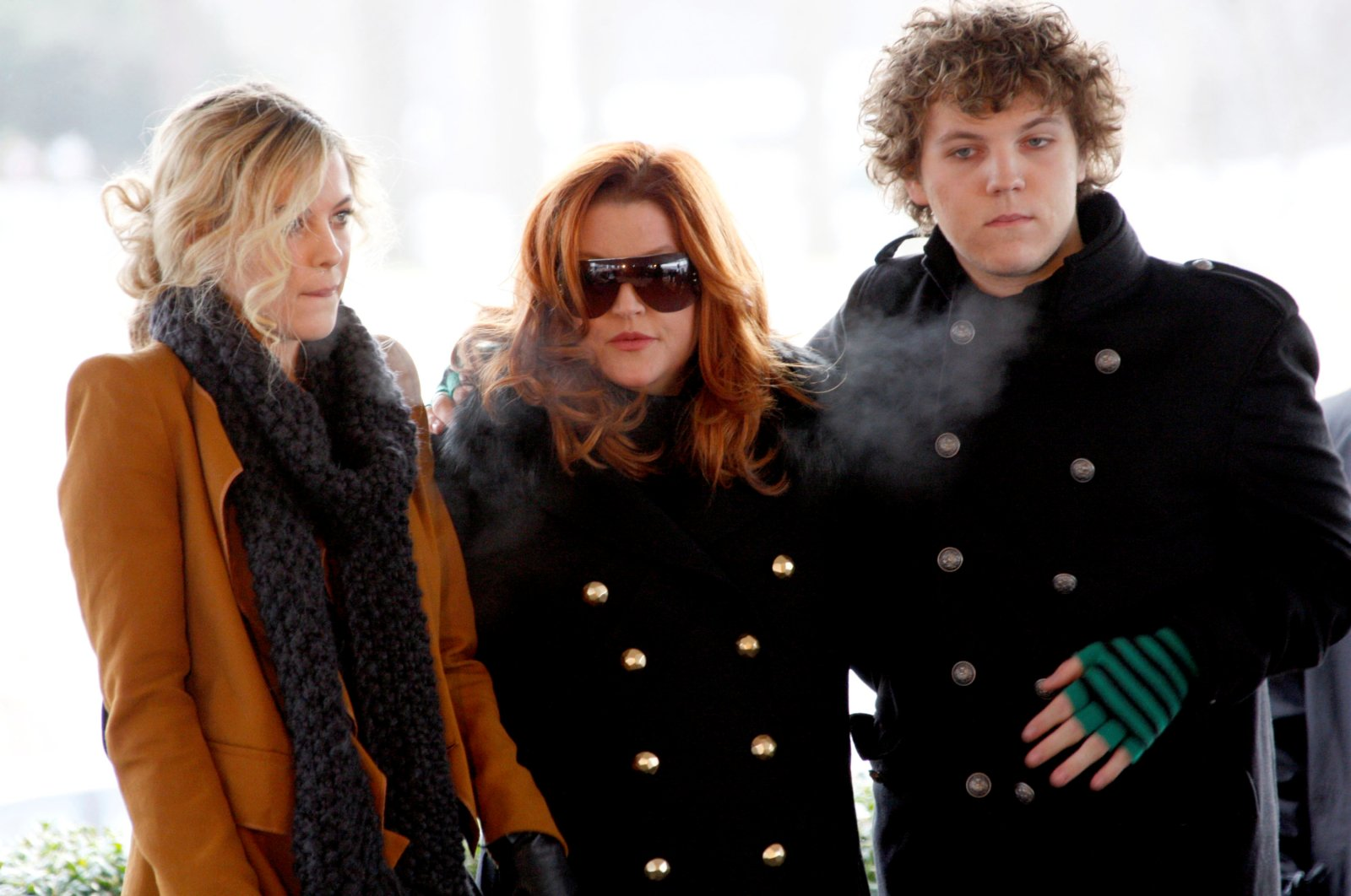 Lisa Marie Presley, with her children Riley and Benjamin Keough, attend the 75th birthday celebration for Elvis Presley in Memphis, Tennessee Jan. 8, 2010. (Reuters Photo)