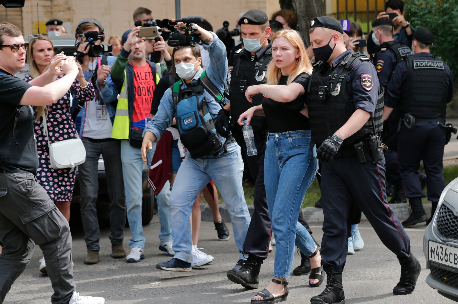 Police officers detain a protester during a rally to support Ivan Safronov near the Lefortovo prison in Moscow, Russia, Monday, July 13, 2020. (AP Photo)