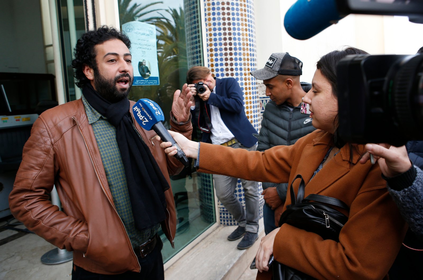 In this March 5, 2020 file photo, journalist and activist Omar Radi speaks after a hearing in Casablanca, Morocco. On Sunday, July 12, 2020, the Tel Aviv District Court rejected a request to strip the controversial Israeli spyware firm NSO Group of its export license over the suspected use of the company's technology in targeting journalists, including Radi, and dissidents worldwide. (AP Photo)