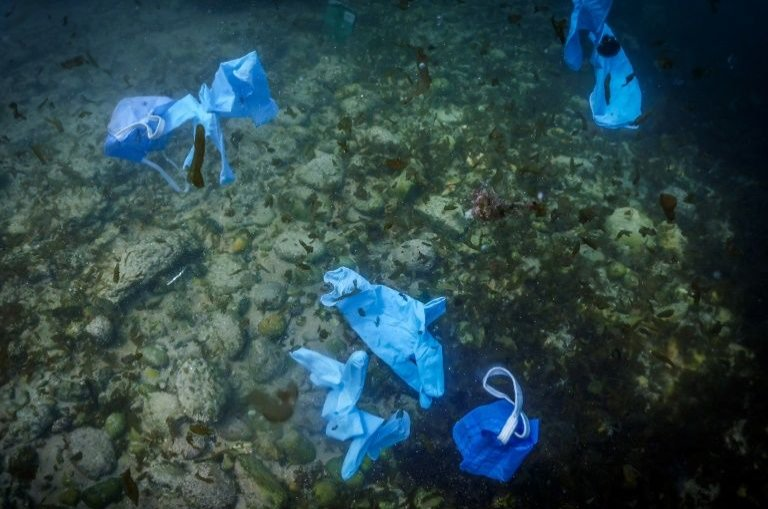 Researchers found disposable masks and gloves used as a protection against COVID-19 in rivers across Europe. (AFP Photo)