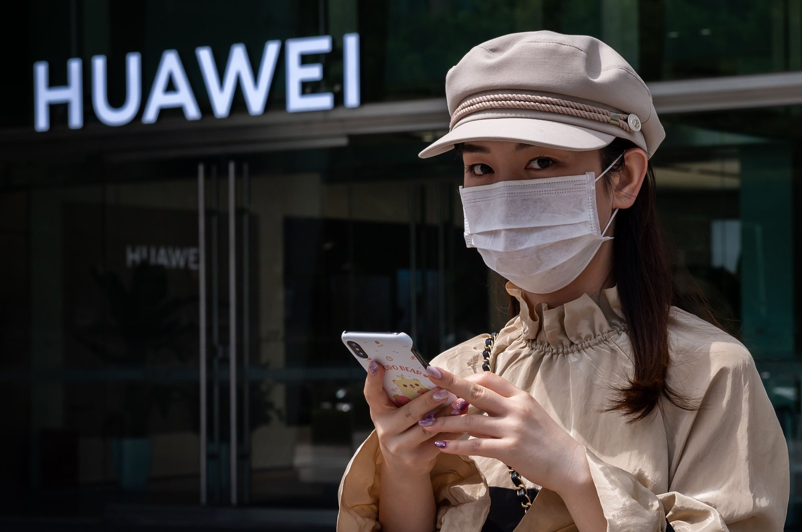 A woman walks past a shop for Chinese telecoms giant Huawei in Beijing, China, May 25, 2020. (AFP Photo)