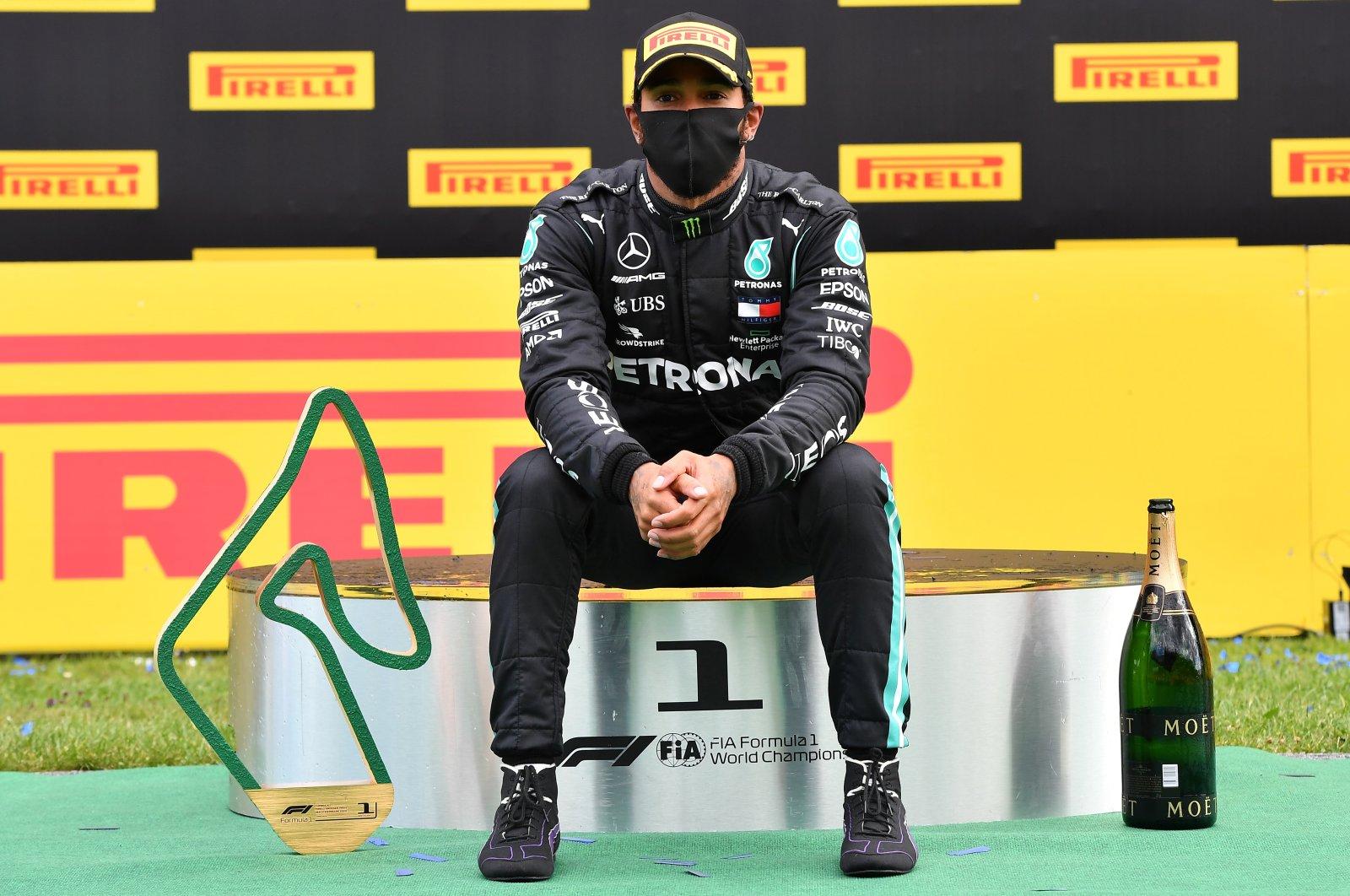 Mercedes' Lewis Hamilton celebrates on the podium after winning the Formula One Styria GP in Spielberg, Austria, July 12, 2020. (EPA Photo)