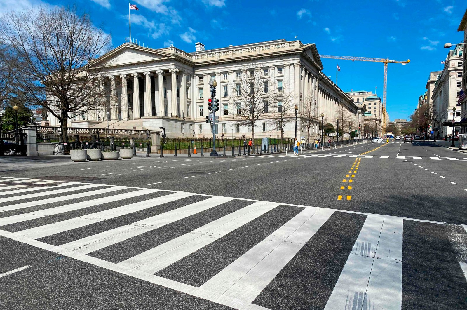 The U.S. Treasury Department building is seen next to an almost empty 15th Street at noon in Washington D.C., U.S., March 13, 2020. (AFP Photo)