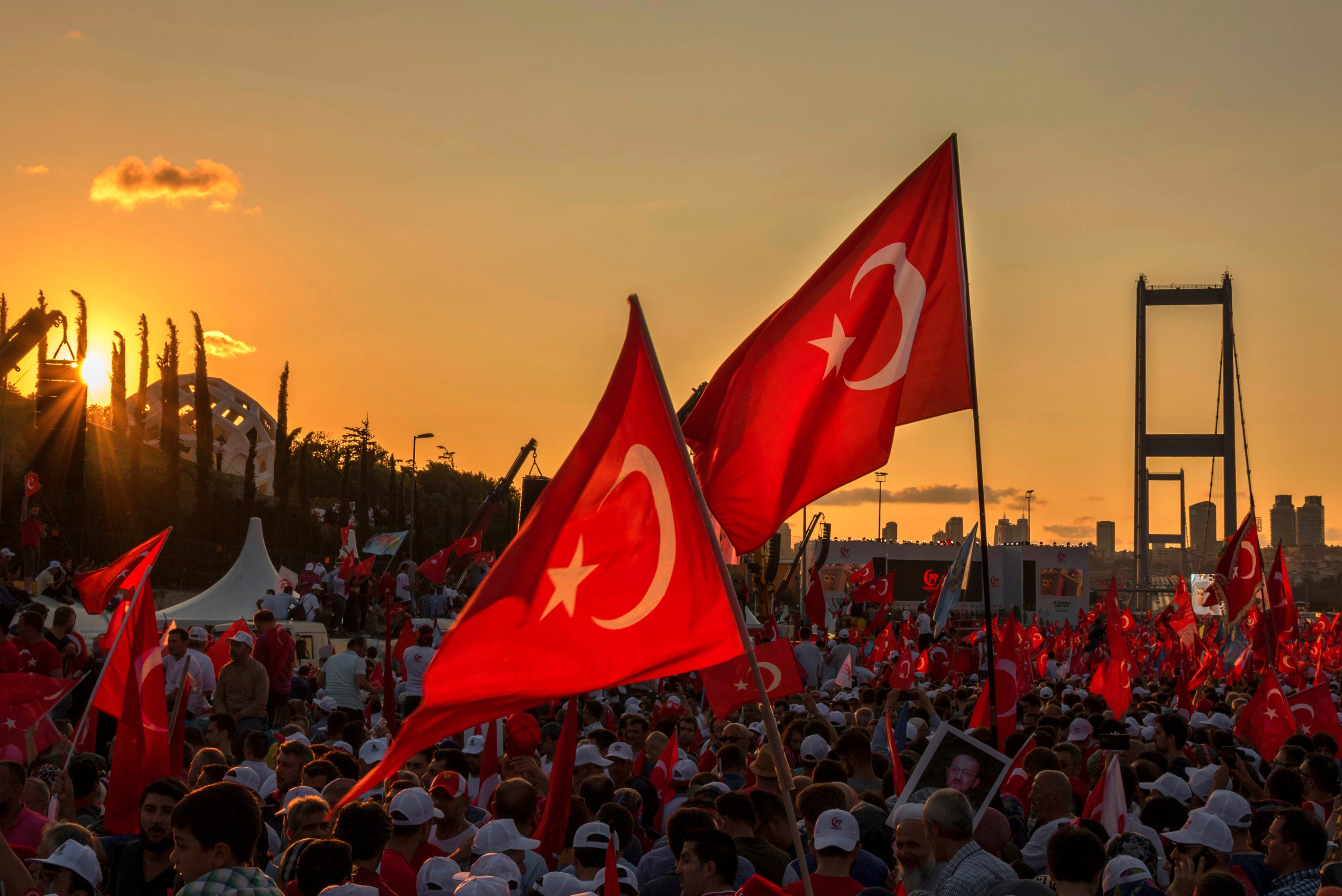 People wave Turkish national flags as they gather in solidarity on the first anniversary of the July 15 coup attempt in Istanbul, Turkey. (Shutterstock Photo)