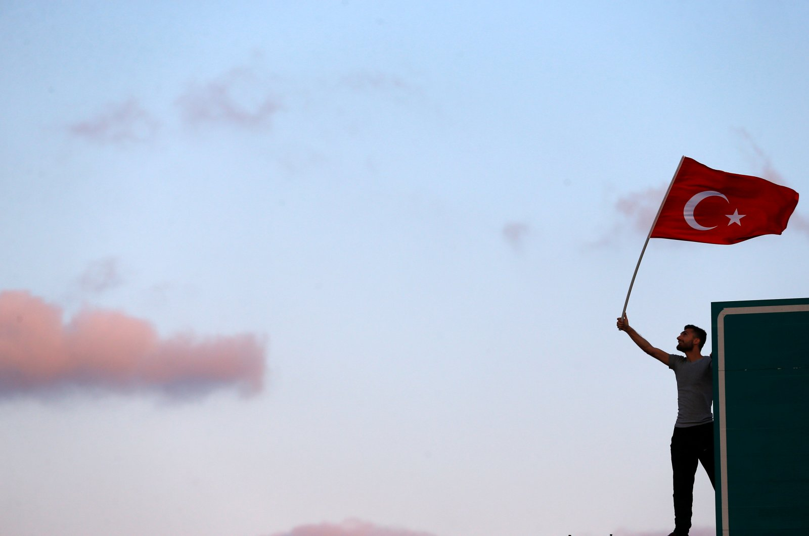 A man waves a Turkish national flag as he attends a ceremony marking the first anniversary of the attempted coup at the July 15 Martyrs Bridge in Istanbul, Turkey, July 15, 2017. (Reuters Photo)