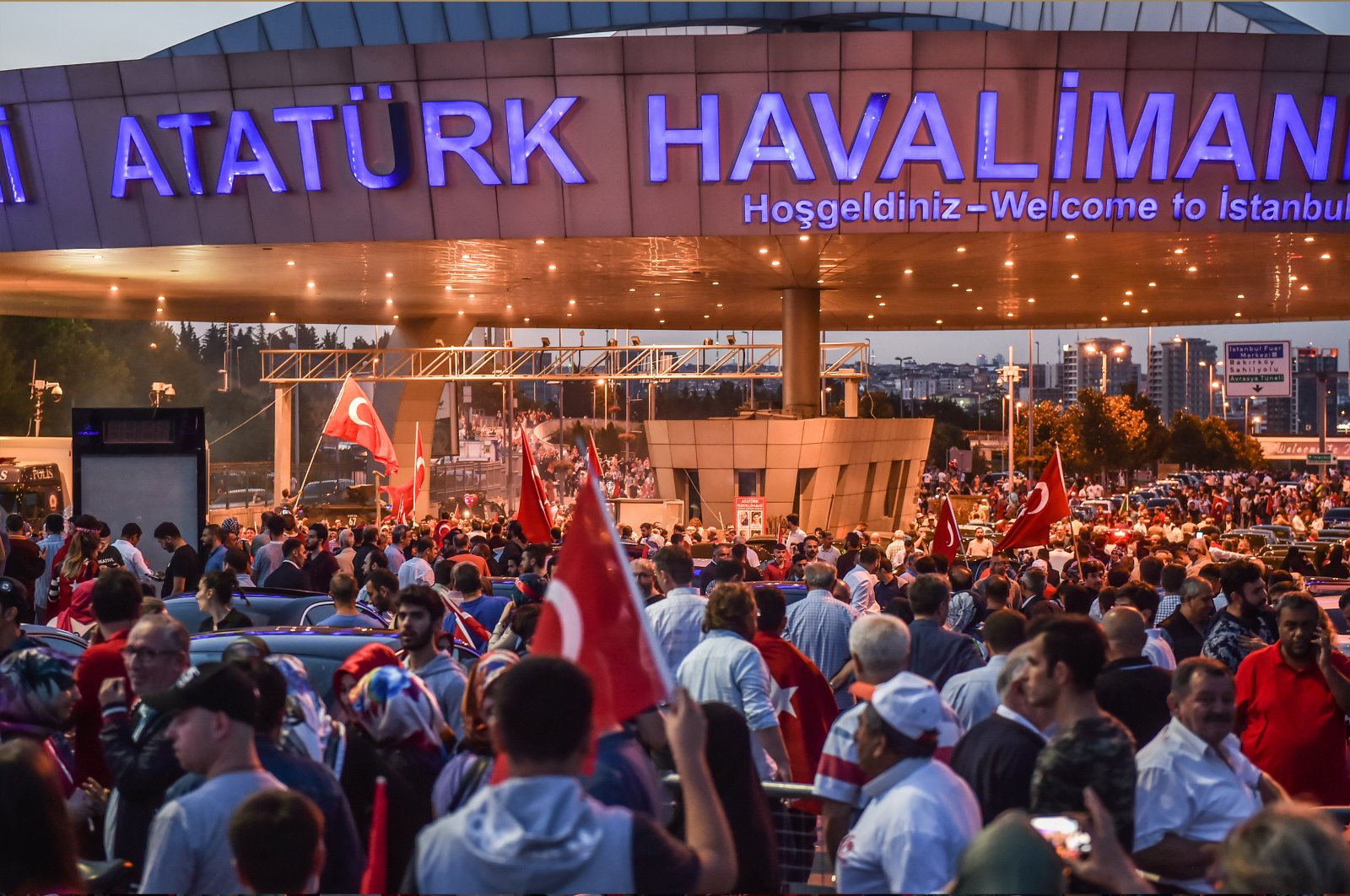 On the third anniversary of the July 15 coup attempt, Turkish citizens rallied at Atatürk Airport to show solidarity. (Shutterstock Photo)