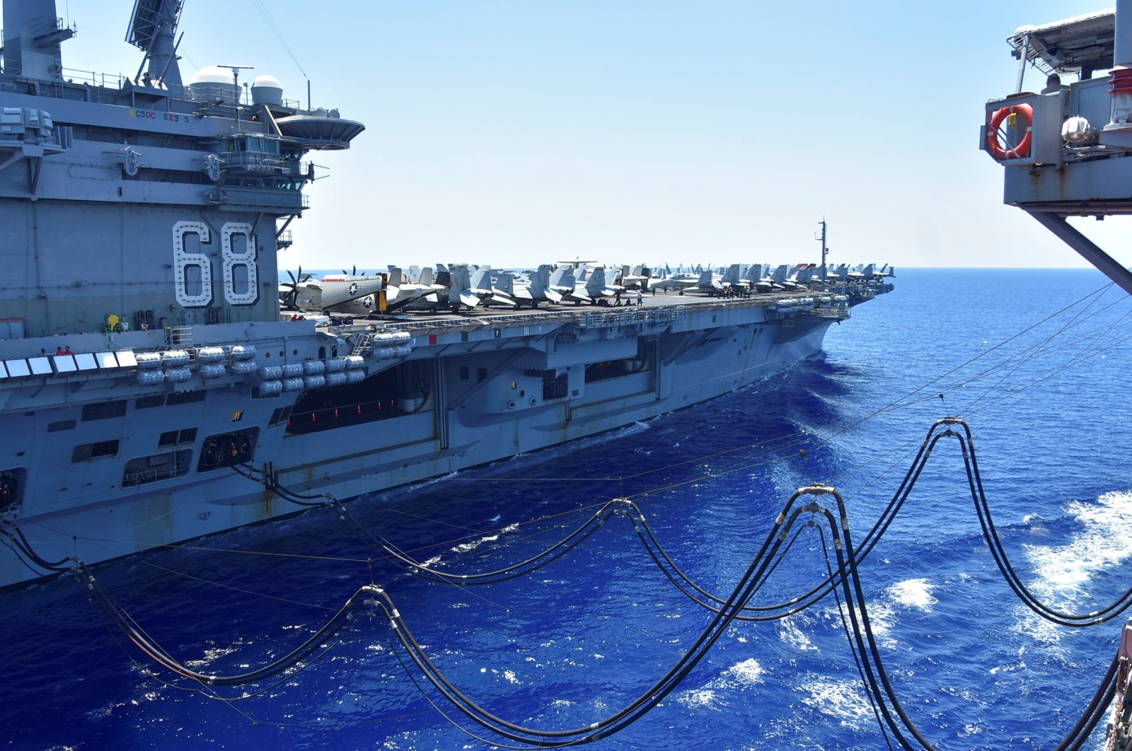 The U.S. Navy aircraft carrier USS Nimitz receives fuel from the Henry J. Kaiser-class fleet replenishment oiler USNS Tippecanoe during an underway replenishment in the South China Sea, July 7, 2020. (Reuters Photo)