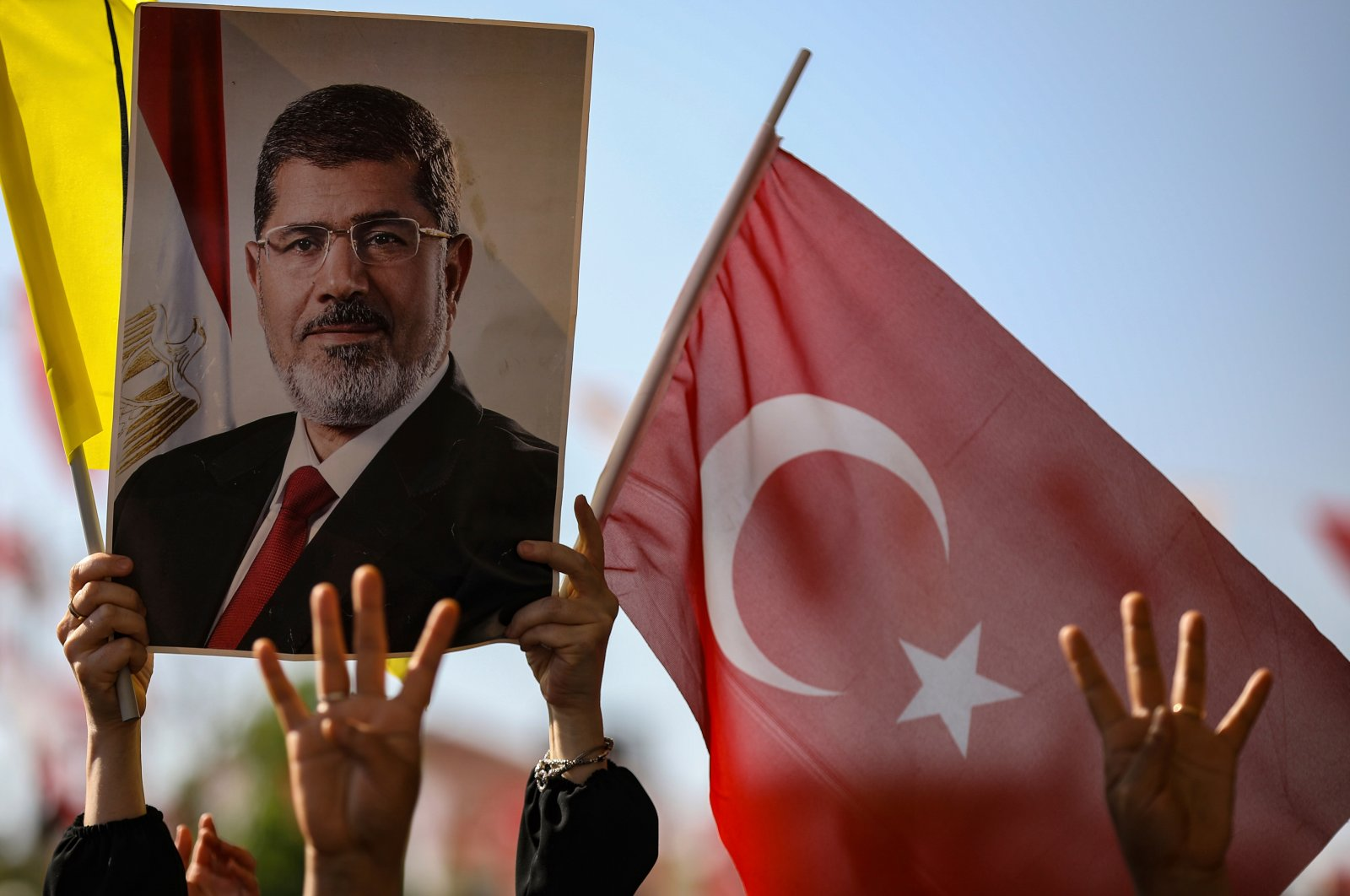 Supporters attend funeral prayers in absentia for ousted former Egyptian President Mohammed Morsi, pictured in the poster, at Fatih Mosque, Istanbul, Turkey, June 18, 2019. (AP Photo)