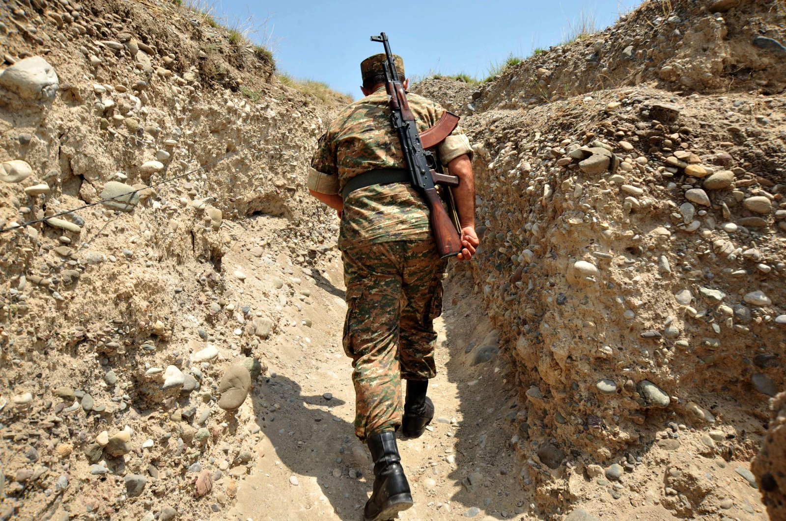 In this file photograph, an Armenian soldier of the self-proclaimed republic of Nagorno-Karabakh walks in a trench at the frontline on the border with Azerbaijan near the town of Martakert, July 11, 2012. (AFP Photo)