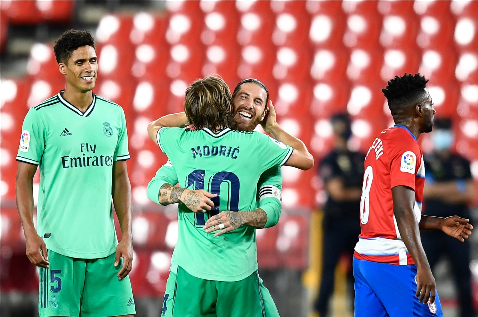 Real Madrid's Sergio Ramos (2nd R) celebrates his team's victory with his teammate Luka Modric during the La Liga match against Granada in Granada, Spain, July 13, 2020. (AP Photo)