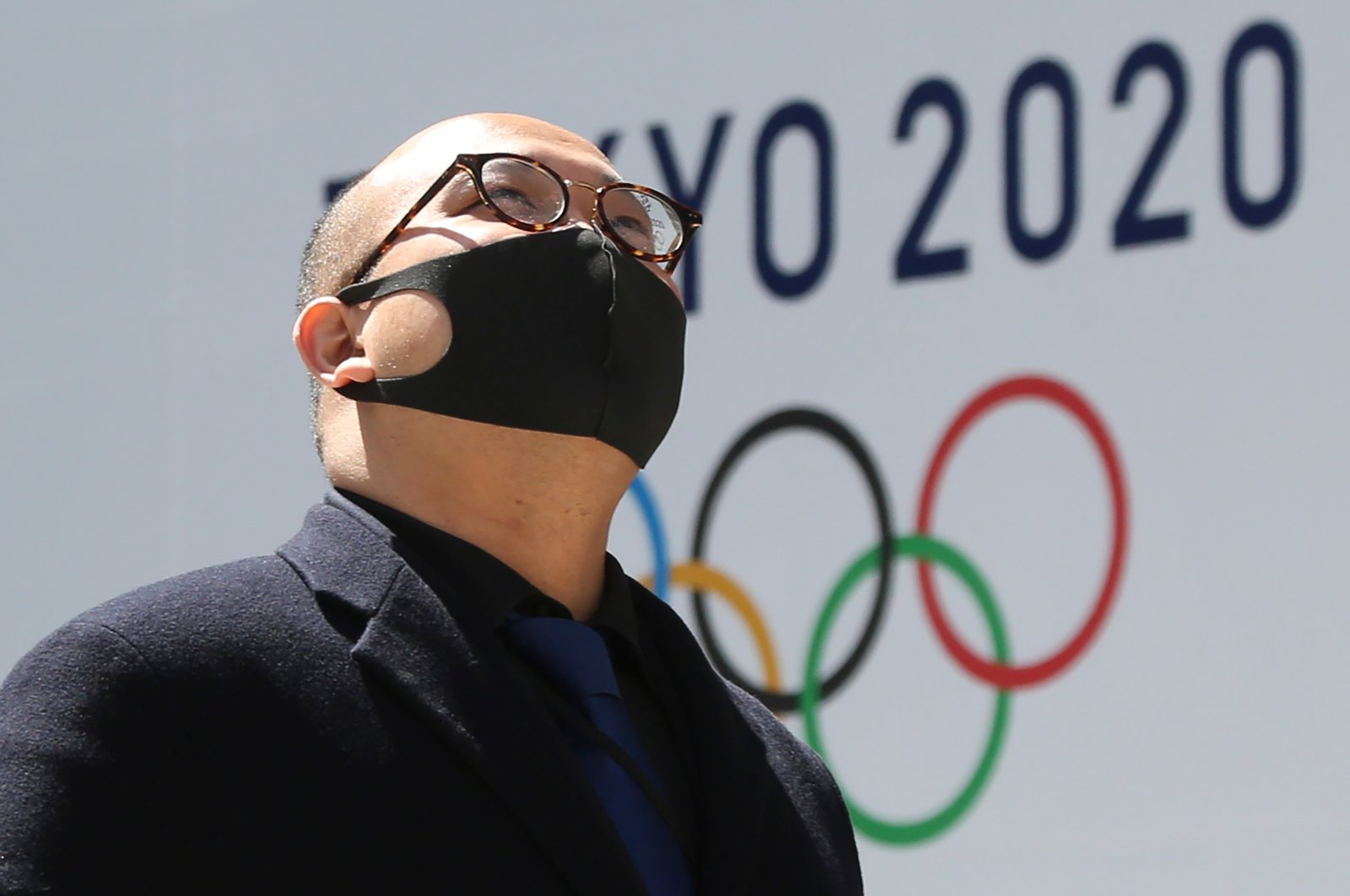 A man walks in front of a Tokyo Olympics logo in Tokyo, Japan, March 25, 2020. (AP Photo)
