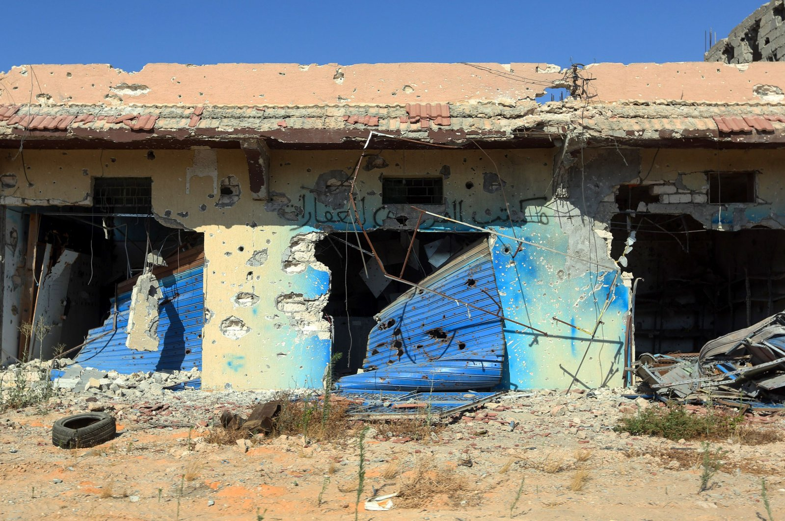 A picture shows a business, damaged during the 14 months of fighting between the UN recognized Government of National Union (GNA) and putschist Gen.Khalifa Haftar, in a southern neighbourhood in the capital Tripoli, July 9, 2020. (AFP)