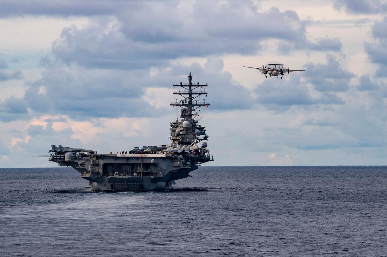 An E-2D Advanced Hawkeye, assigned to the Tigertails of Carrier Airborne Early Warning Squadron (VAW) 125, flys past the aircraft carrier USS Ronald Regan (CVN 76) during a drill in the South China Sea, July 6, 2020. (EPA Photo)