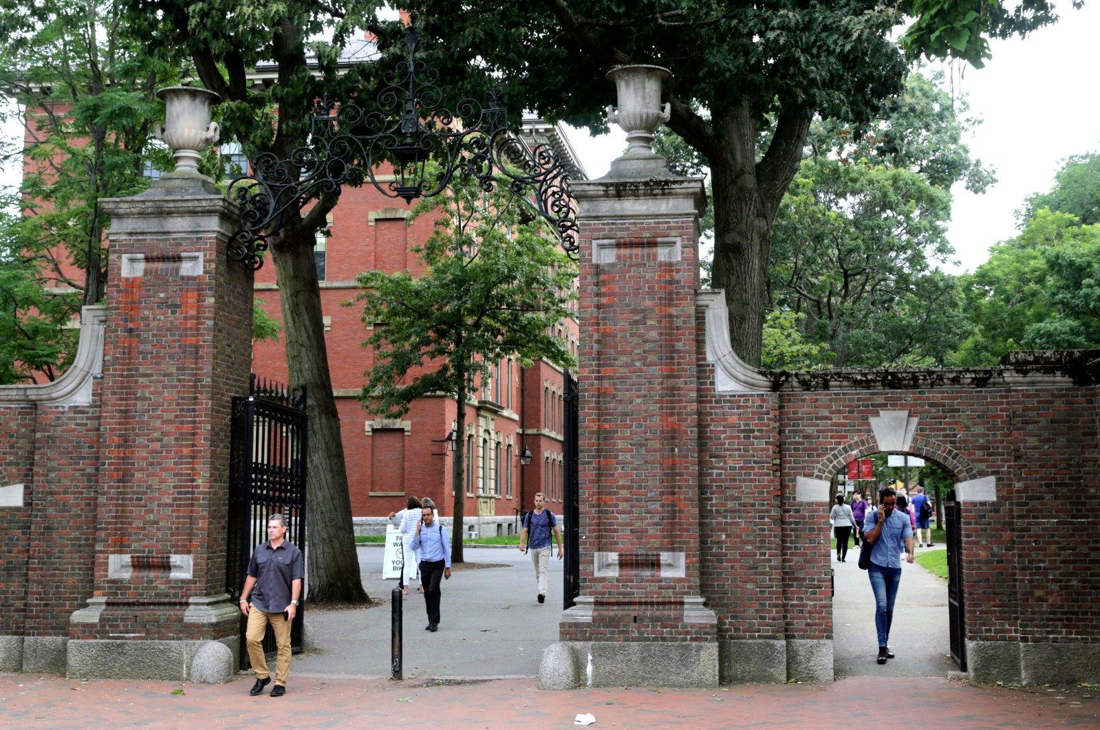 Pedestrians walk through the gates of Harvard Yard at Harvard University in Cambridge, Massachusetts, U.S., Aug. 13, 2019. (AP Photo)