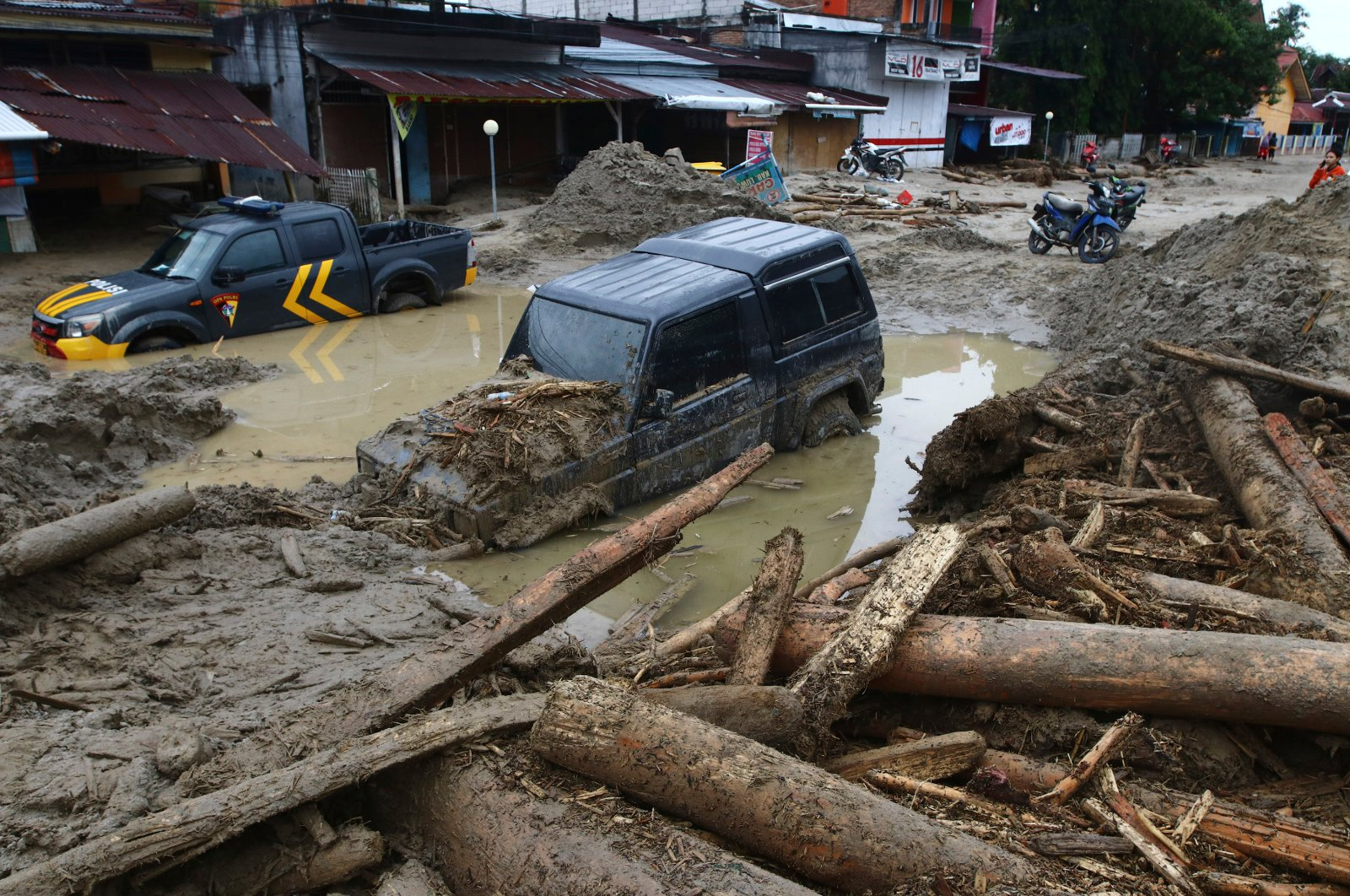Cars are stuck in mud at an area affected by flash flood in Masamba, South Sulawesi province, Indonesia, July 15, 2020. (AP Photo)