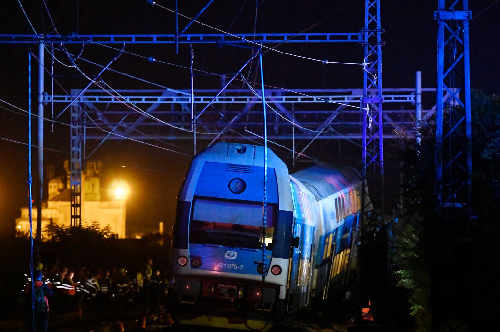 Rescuers work at the scene of a collision between passenger and freight trains in Cesky Brod, east of Prague, Czechia, July 14, 2020. (AP Photo)