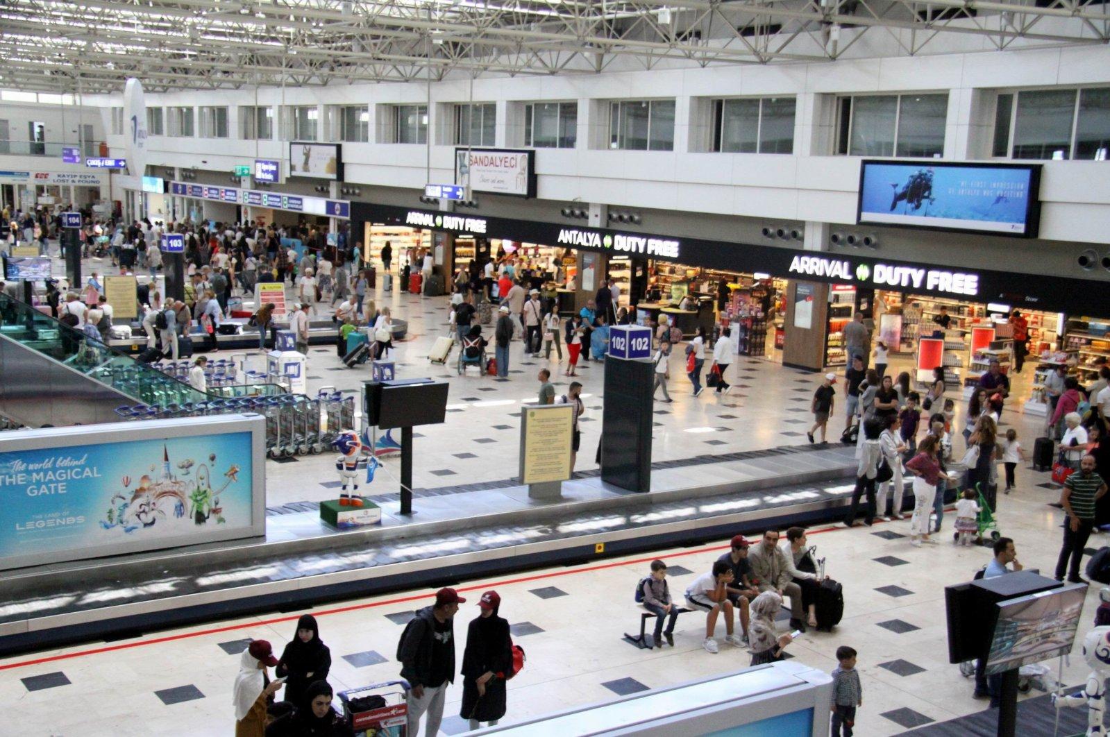 People are seen at Antalya Airport, Antalya, Turkey, Aug. 27, 2018. (IHA Photo)
