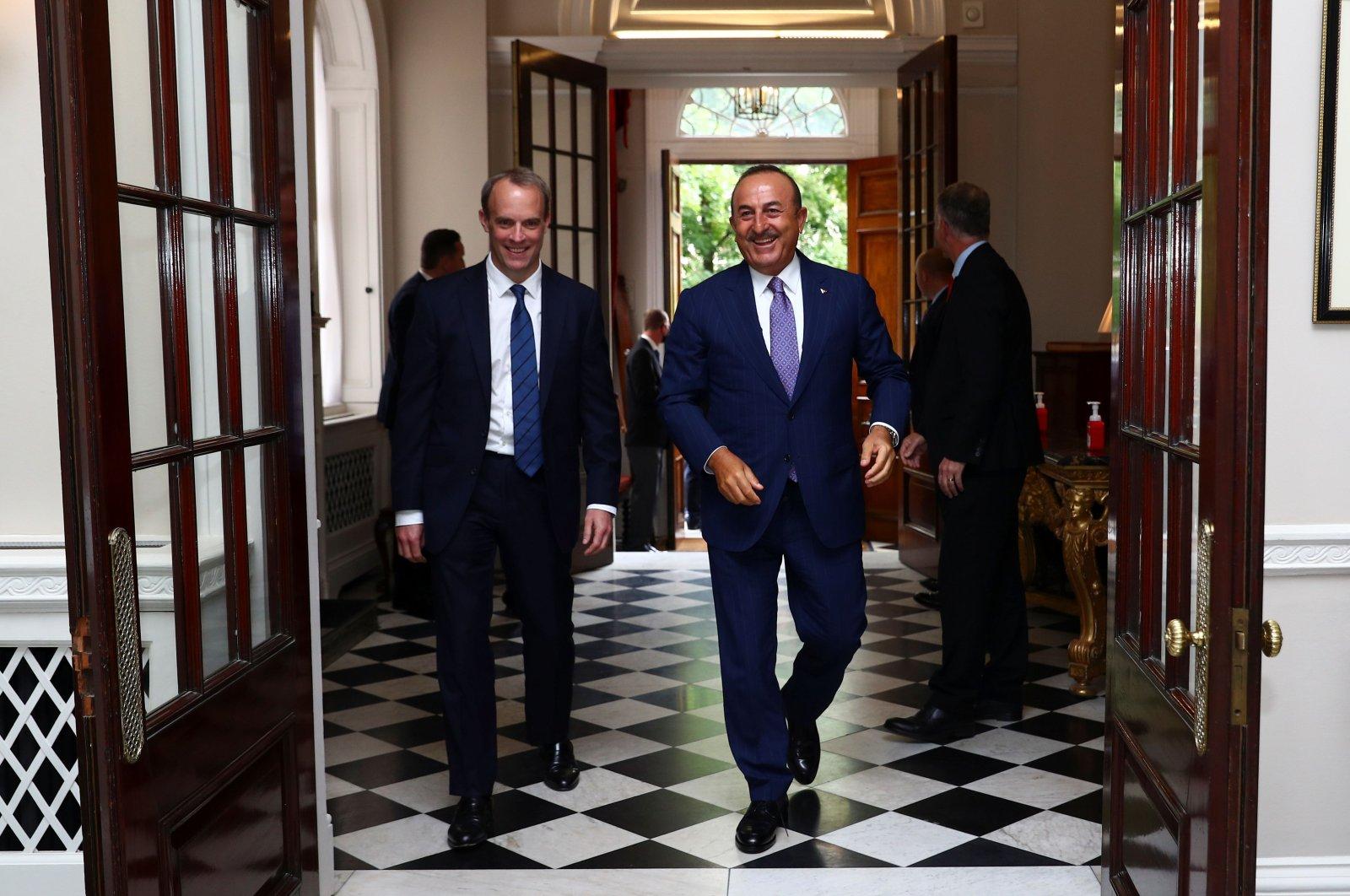 British Foreign Secretary Dominic Raab (L) and his Turkish counterpart Mevlüt Çavuşoğlu walk at Carlton Gardens ahead of a meeting in London, July 8, 2020. (AFP Photo)