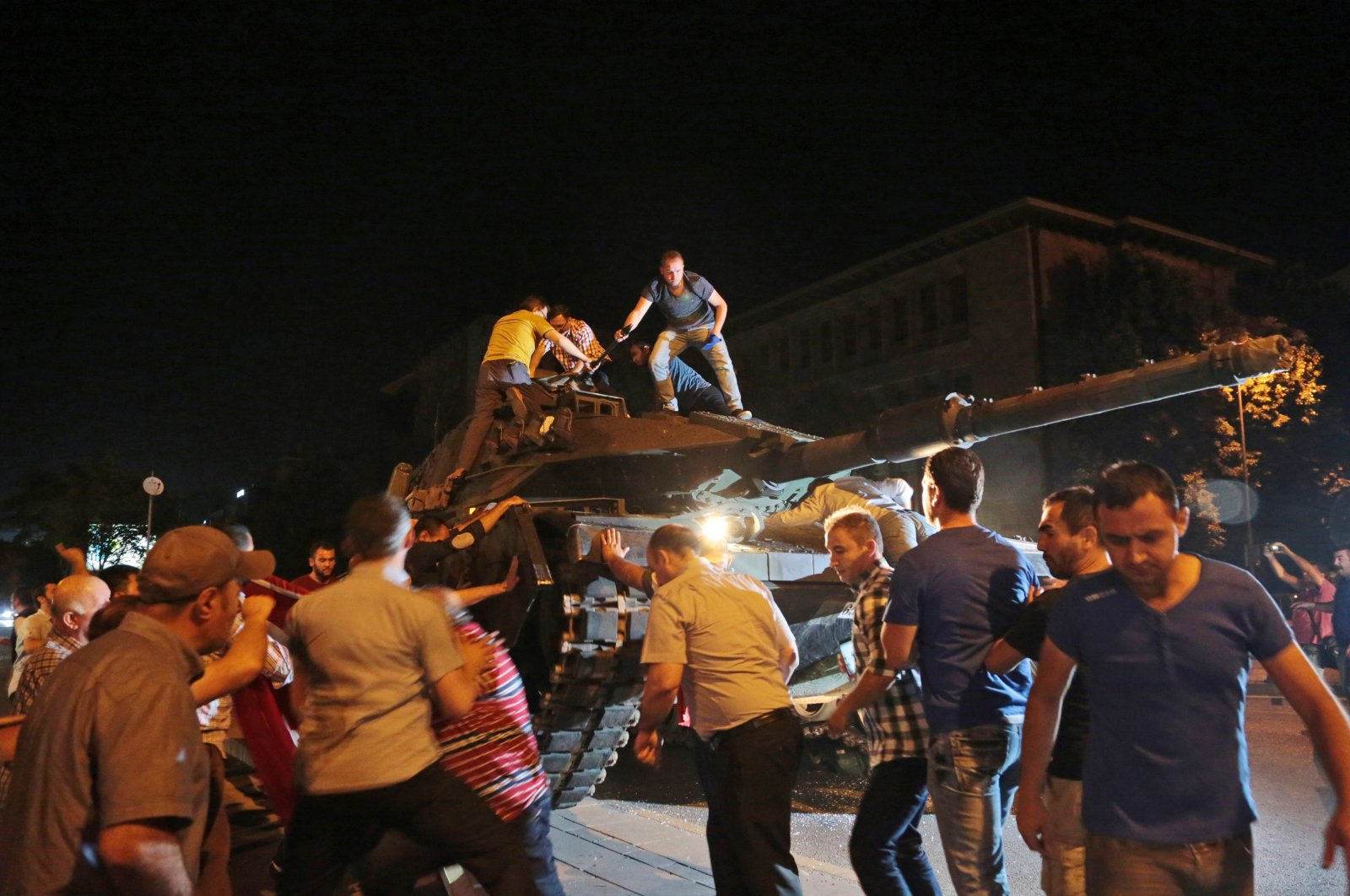 In this late Friday, July 15, 2016 file photo, tanks move into position as people attempt to stop them, in Ankara, Turkey, during the coup attempt. (AP File Photo)