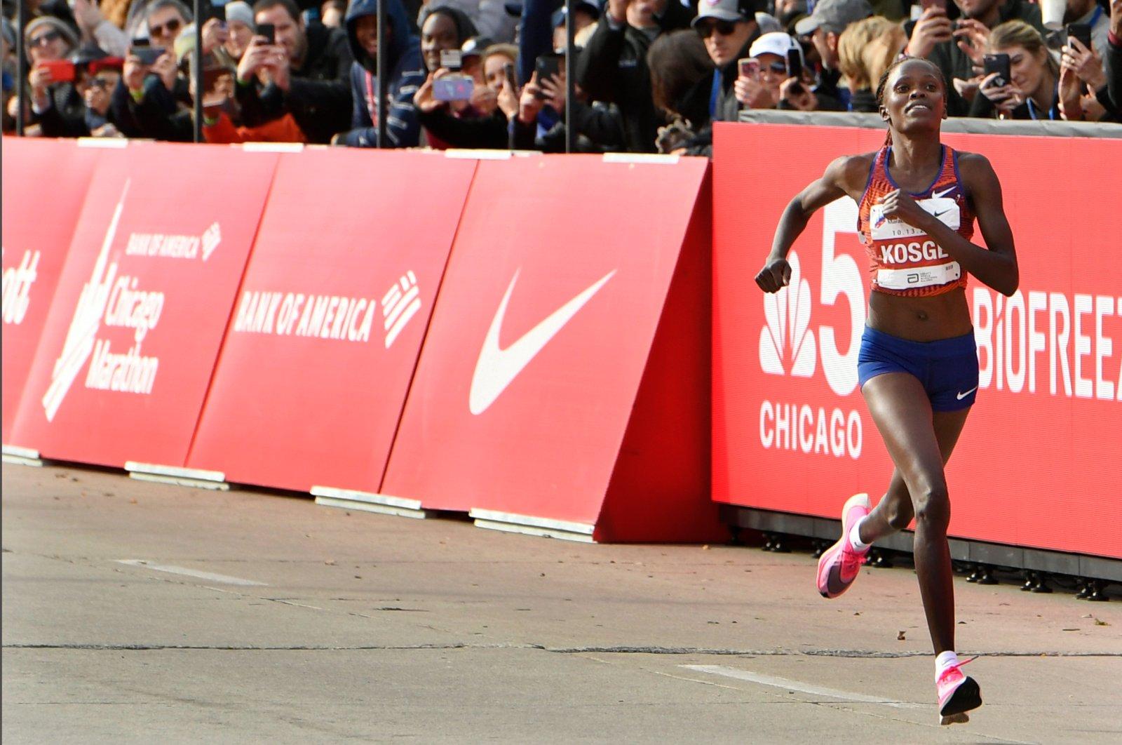 Brigid Kosgei of Kenya wins the Women's Chicago Marathon while setting a world record of 2:14:04, Chicago, U.S., Oct. 13, 2019. (AP Photo)