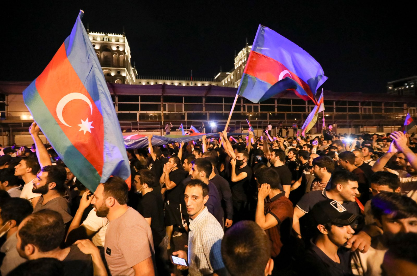 People carry Azerbaijan's national flags as they rally in support of Azerbaijan's army in Baku, Azerbaijan, Tuesday, July 14, 2020. (AP Photo)
