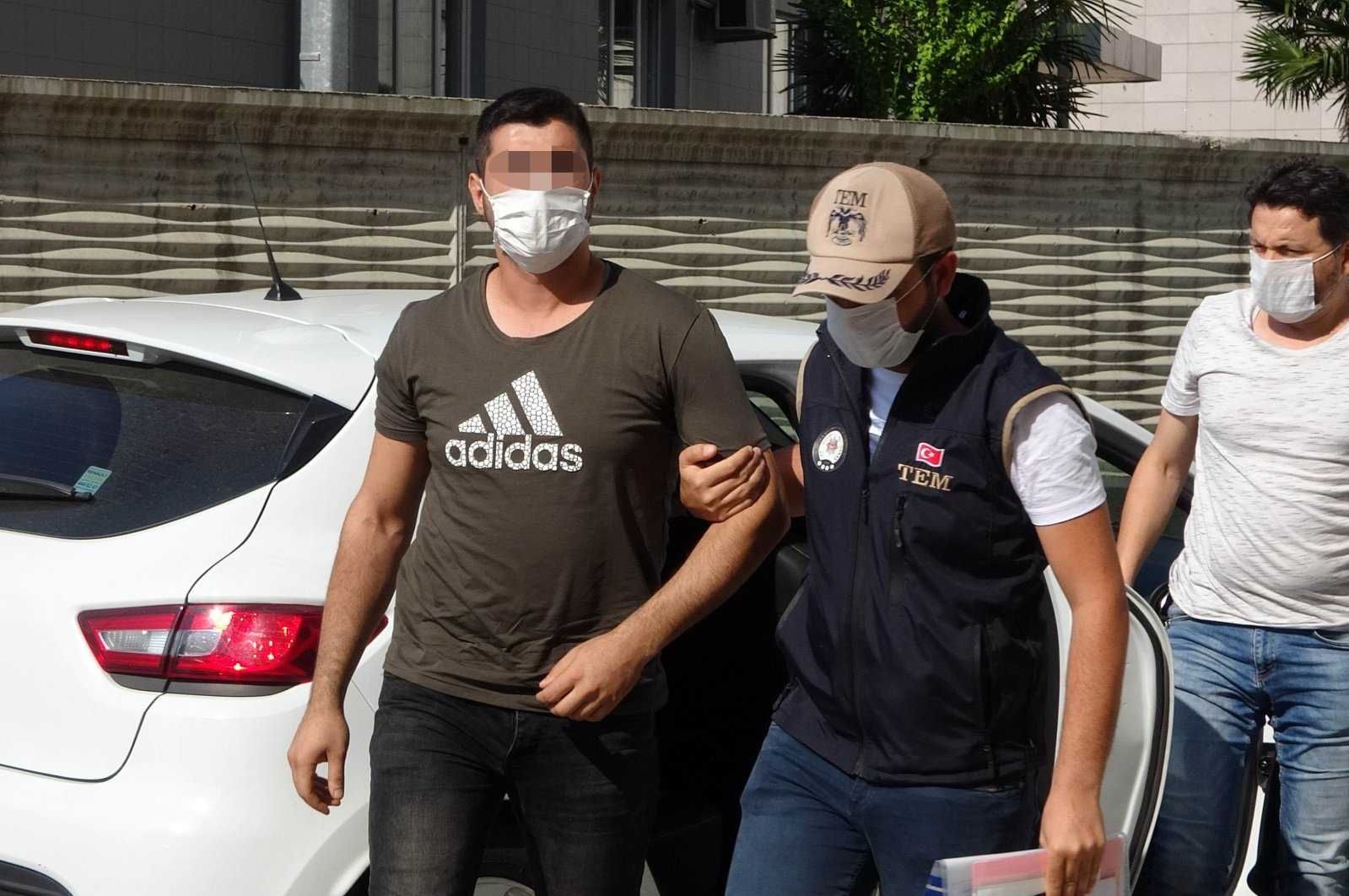 Police escort a FETÖ suspect to the police station after his capture, in Samsun, Turkey, July 14, 2020. (IHA Photo)