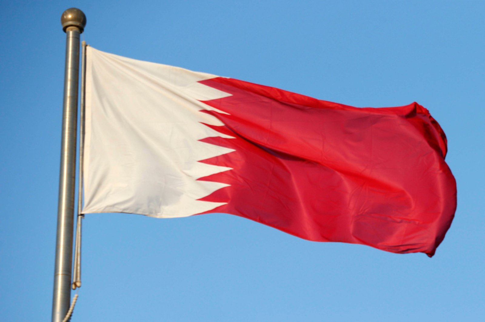 This file photo shows the Qatari national flag hoisted in Berlin, Germany on Feb. 27, 2020. (Reuters Photo)