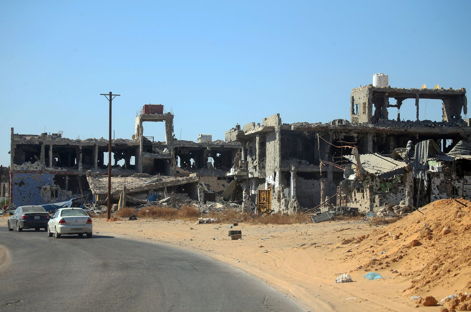 Residential buildings, damaged during the 14 months of fighting between the U.N.-recognized Government of National Accord (GNA) and putschist Gen. Khalifa Haftar, are seen in a southern neighborhood in the capital Tripoli, Libya, July 9, 2020. (AFP Photo)