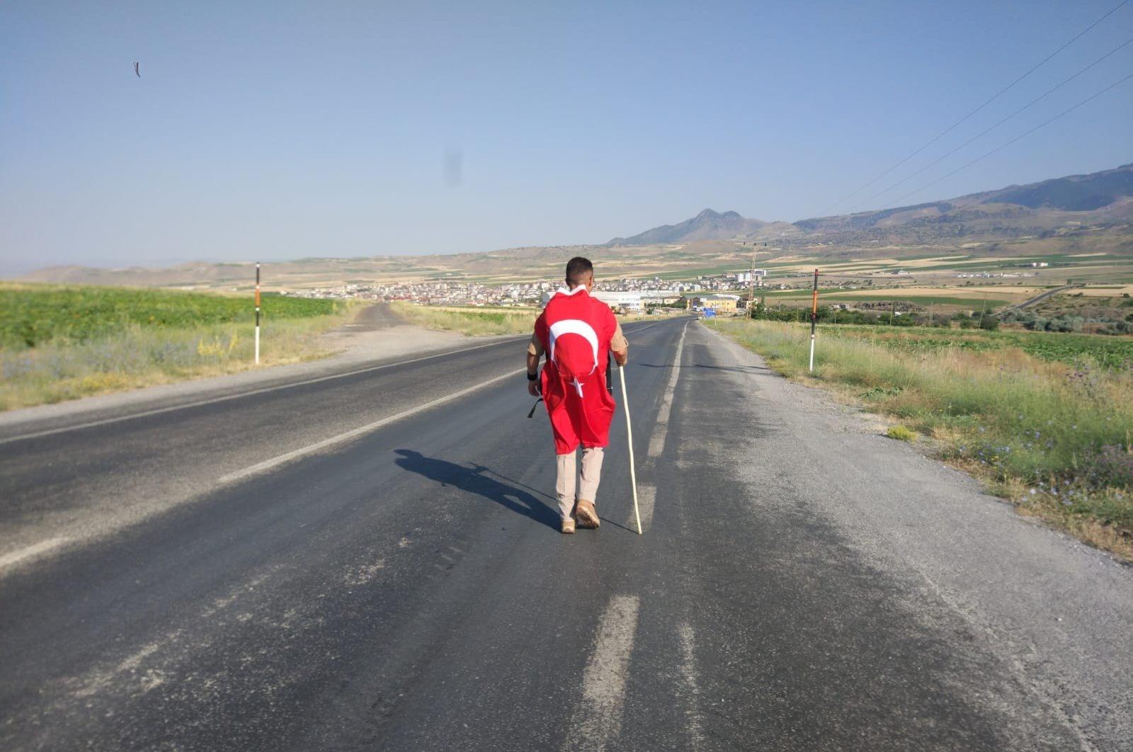Bünyamin Yurdakul walks to downtown Develi, in Kayseri, Turkey, July 15, 2020. (İHA Photo)
