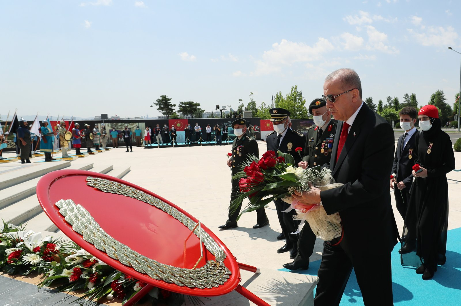 President Recep Tayyip Erdoğan places a wreath on the July 15 Martyrs' Monument during a commemoration ceremony at the Beştepe Presidential Complex in the capital Ankara, Turkey, July 15, 2020. (AA Photo)