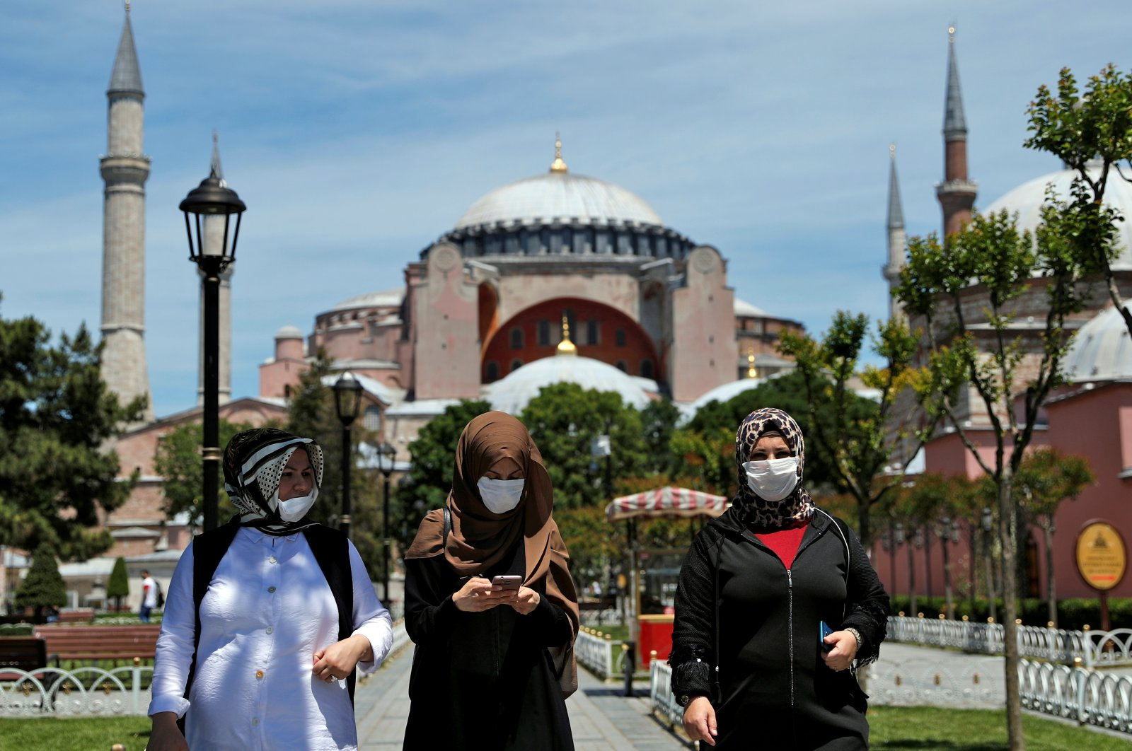 Women wearing face masks walk in front of the Hagia Sophia Mosque at the popular tourist spot Sultanahmet Square, Istanbul, Turkey, June 5, 2020. (Reuters Photo)