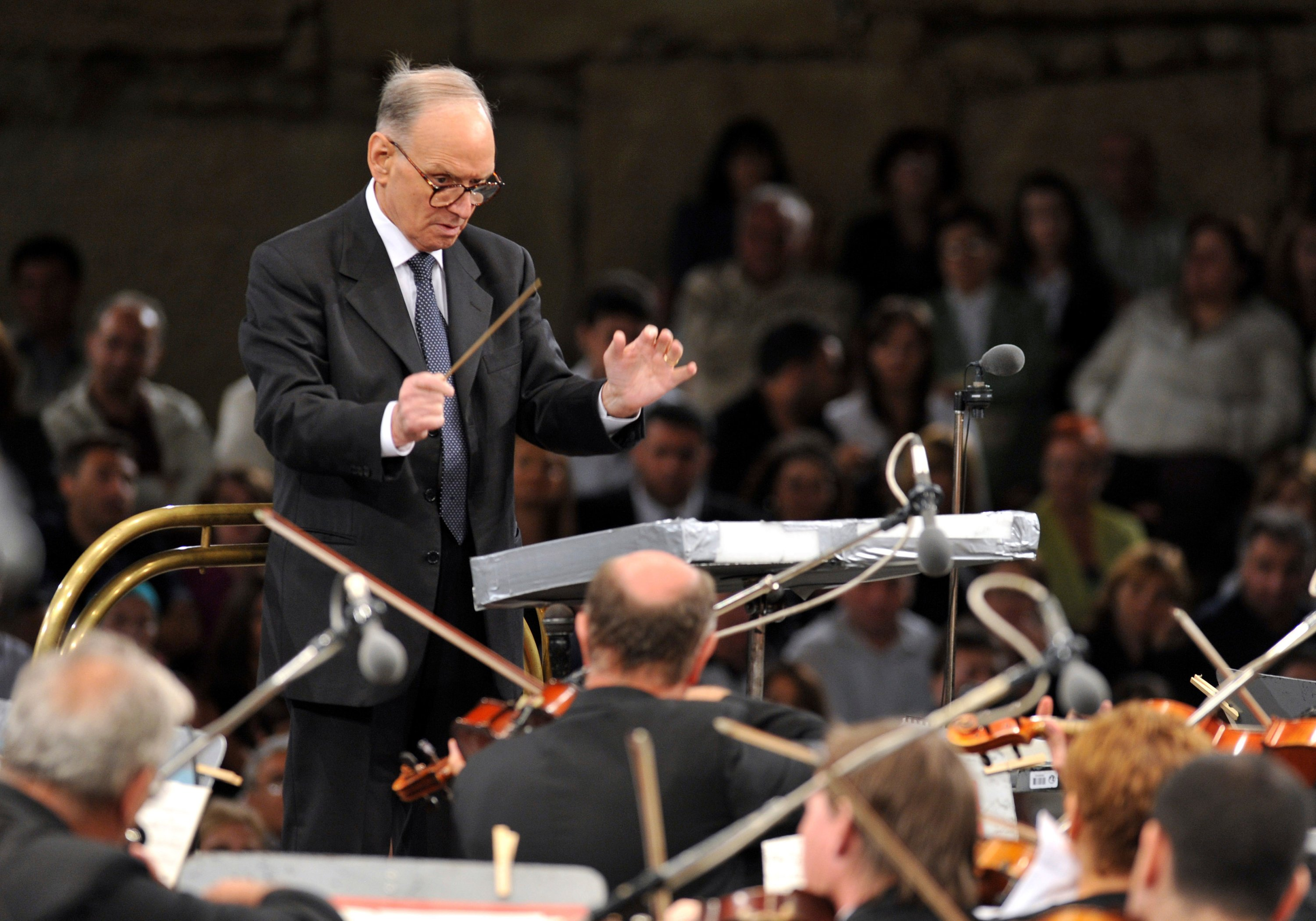 Composer Ennio Morricone, conducts with the Budapest Symphonic Orchestra in Macedonia, on July 12, 2009. (AP Photo)