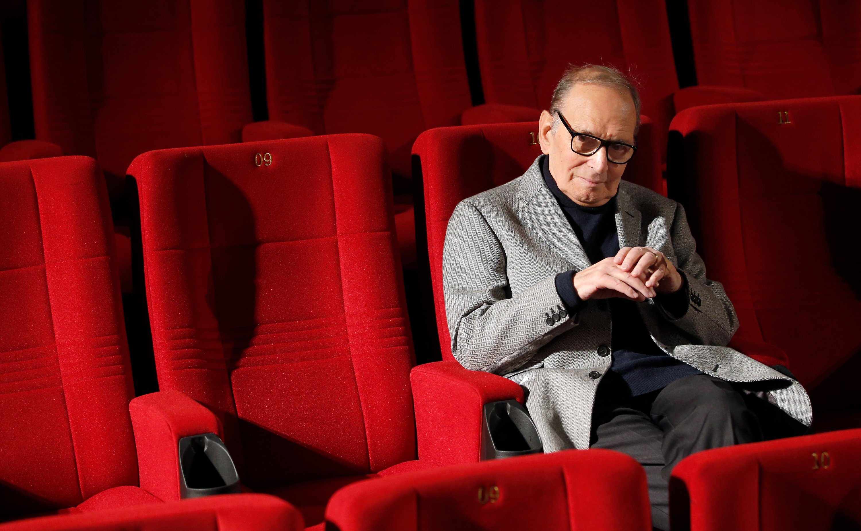 Ennio Morricone, composer and conductor from Italy, poses during a photo call to promote his German 2014 concerts, in Berlin, Germany, Dec. 6, 2013. (AP Photo)