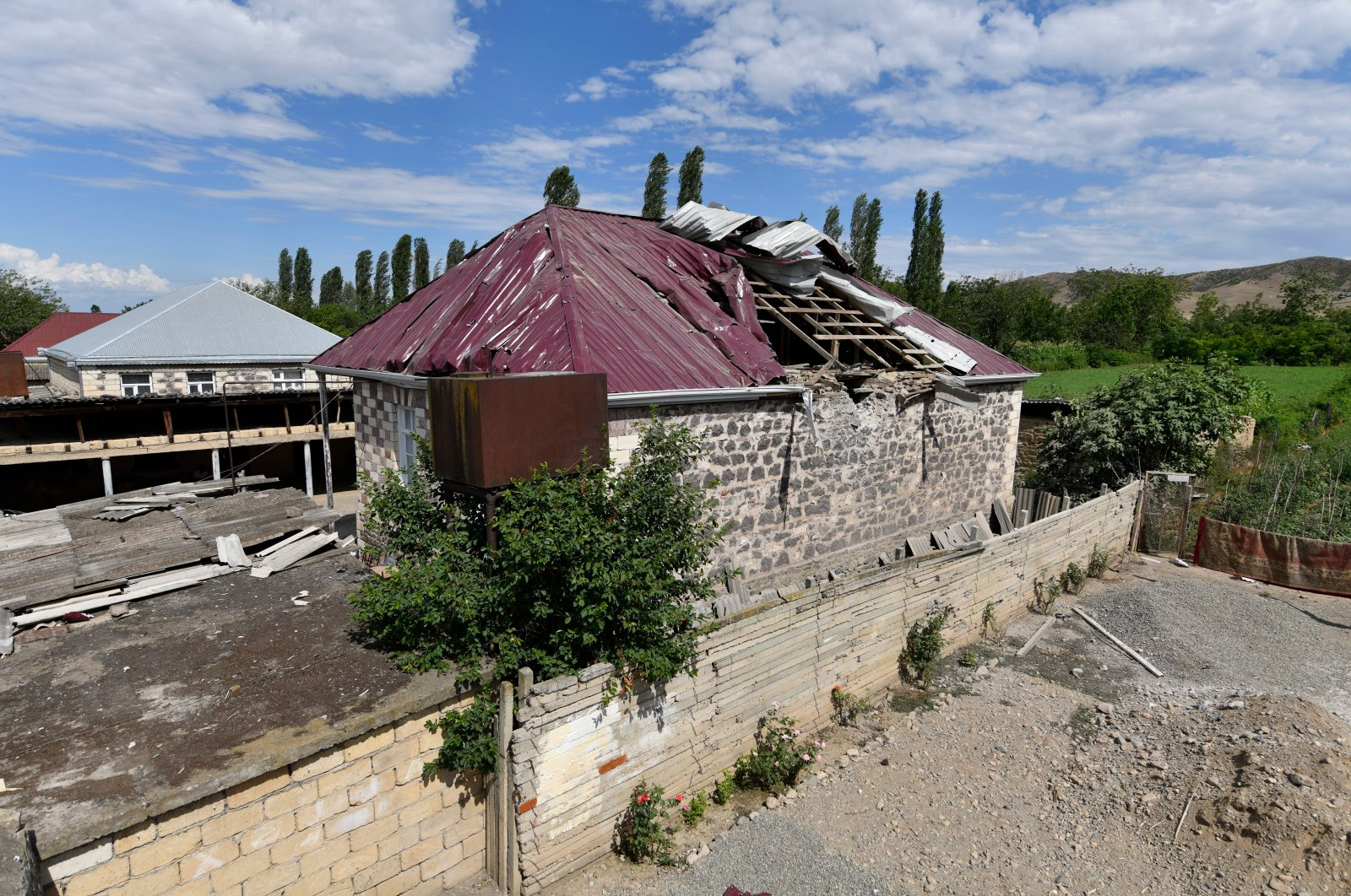 A damaged house is seen after shelling by Armenian forces in the Tovuz region of Azerbaijan, Tuesday, July 14, 2020. (AP Photo)
