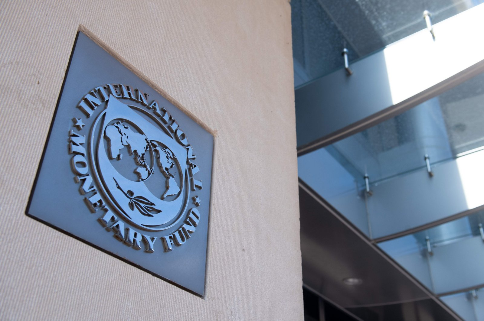 A sign is seen outside the headquarters of the International Monetary Fund (IMF) as the IMF and World Bank hold their Spring Meetings virtually due to the outbreak of COVID-19, known as coronavirus, in Washington, D.C., April 15, 2020. (AFP Photo)